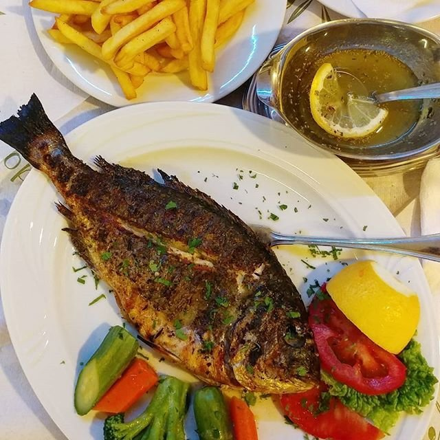 🇬🇷 : So many nice beaches and towns to explore throughout Corfu Island. Stopped by Agios Stefanos for a bite at the Kaparelli Taverna this evening 🙂 #onthetable : Whole grilled sea bream/ Saganaki/ Fried Sardines/ Feta in the oven. #grilledfish #seabream #seafood #greekcuisine #corfufood #agiosstefanos #kaparellitaverna #canadianfoodie #foodie #travelandfoodie #food #igsfood #localproducts #visitcorfu #corfu