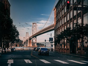 Fun fact: The San Francisco-Oakland Bay Bridge is two stories high, and sits at a massive 4.5 miles in length!    What's your favorite place to photograph in Cali? 📸   _____________________________________ #SanFrancisco #Oakland #westcoast #Panasonic #polarpro #gh5 #gh5photography #mirorless #baybridge #mirrorlessgeeks #travel #roadtrip #photography #SF #bayarea #vibes