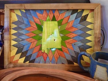Acadian Works made this stunning wood inlay tray with the state quilt pattern exclusively for us in honor of Alabama's bicentennial!😍 A very special, one of a kind piece, in store today at Everything Alabama!♥️ . #everythingalabama #stateofalabama #al200 #alabama200 #alabamabicentennial #bicentennial #sweethomealabama #alabama #alabamamaker #alabamamade #alabamagifts #alabamagoods #madeinalabama #madeinthesouth #handcrafted #craftsmanship #woodinlay #marquetry #historicdowntownprattville #shoplocalbama #shopeverythingalabama #shopalabama