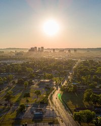 Flying by Legion Field I finish up and turn my drone back towards me to land and what do I see? I see a magnificent shot of this hazy Birmingham skyline. Really impressed with the way the trees' shadows cascaded across the land. • • Follow us! dronealabama #funkdrone