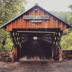 "On this ""farm drives"" kick, today I'm sharing another side of the road find. I had a few hours to kill in between serving as a day camp shuttle for a sweet kiddo. I saw a sign leading to this off a windy mountain road. Horton Mill Covered Bridge was built in 1934 and was the first covered bridge in the southeastern United States to be added to the National Register of Historic Places. It's also the highest covered bridge above any U.S. waterway at 70 feet above Little Warrior River. It's also close to a lot of farmland, so that counts, right?? . . . #farmwalks #farmdrives #hortonmillcoveredbridge #blountcounty #littlewarrior #coveredbridge #nationalregisterofhistoricplaces #thisisalabama #raw_hidden_talent #onlyinalabama #femaleshutterbugs #soulgrown_alabama #alabamathebeautiful #iamcountryside #countryviews #raw_seasons #countrylook #stopandstare #mycountry #mycountryhome #mycountrylife #countryview #oldwood #woodensign"