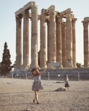 Photo by miss_luckypony, caption reads: We took the kids to see The Temple Of Zeus. This magnificent structure was once made up of 104 of these massive columns, it was amazing just seeing the few still standing so I can't imagine what it must have looked like in all its glory. It really was awesome to see it, but I had to laugh at my two kids :) Rex kept pointing at it shouting ROCK ROCK and Nina was more interested in collecting these weird beetles that were on the ground that looked like ladybirds 🐞😬 . . . . . . . . . . . . #lucky_travels #greecestagram #ninajamesdurrant #rexphilipdurrant #wanderlust #travelblogger #travelgram #travel_book #travelcaptures #beautifuldestinations #welovetoexplore #athens #athensgreece #streetsofathens #olympicstadium #zeus #zeustemple #stadium #ancientruins #explore #exploregreece