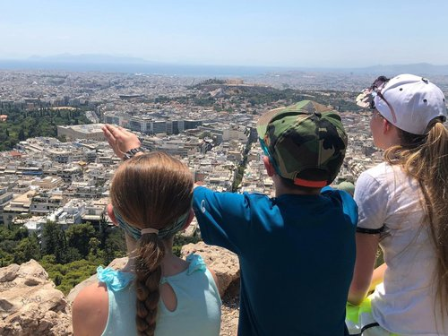 Photo by wren_light, caption reads: We have hiked more than 15 miles, up, down and all around Athens in the past two days. ⠀ ⠀ ⠀ So much history, sweeping views, and an abundance of ☀ (and, consequently, heat). ⠀ ⠀ ⠀ I'm proud of my kids for keeping up pace🚶🏼♀️🚶🏻♂️🚶🏻♀️ and not complaining! They are truly the most resilient travelers🧳. ⠀ ⠀ ⠀ I am 😀 they are growing up with such 💰 experiences. ⠀ ⠀ ⠀ I constantly tell them how fortunate they are to see so much of the 🌎.⠀ ⠀ ⠀ ⠀ ⠀ ⠀ ⠀ ⠀ ⠀ ⠀ ⠀ ⠀ ⠀ ⠀ ⠀ ⠀ ⠀ ⠀ ⠀ ⠀#thisisreallife #travel #traveling #wanderlust #adventure #lovemykids #photography #family #familygoals #europe #european #greece #athens #exploring #happy #lovemylife #travelgram #instagood #instagram #instapic #insta #instago #instamom #instamoments #sunset #fun #photo #explore #summer #grateful