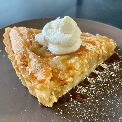 "poached 🍐 and brown butter custard tart with a bourbon-cider reduction and Greek yogurt chantilly... and an orange zest pâte sucrée ""if you wanna get fancy"" - @benhayes42 #shoutouttoallthepears"