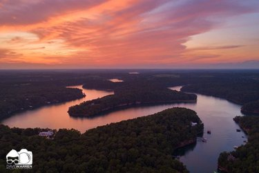 Photo by freestateoutfittersco, caption reads: dave_warren80 does it again with this perfect photo of last night's sunset over Smith Lake's Willoughby Branch 😍