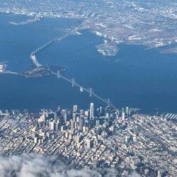 Downtown San Francisco and Bay bridge (SF-Oakland Bridge). #sanfrancisco #california #sfdowntown #baybridge #sanfranciscooaklandbaybridge #californiaroadtrip #sfoairport #fromaplane #photofromabove #salesforcetower #transamericapyramid #sfobayarea #sanfranciscobay