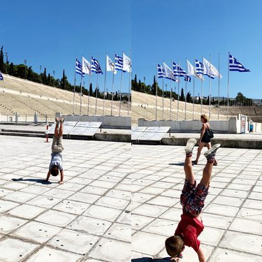 Photo by mpidcoe, caption reads: Just a couple of the coolest kids I know doing their thing... in the first modern Olympic stadium in the world in the city that started it all. #olympics #athens #greece #mediterranean