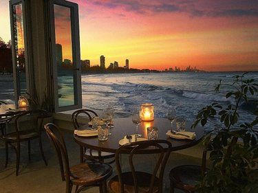 Sunsets don't come much better than this, but coupled with a view from @imrickshores, the suburb of Burleigh is hard to go past.🌇 Home to some seriously droolworthypan-Asian inspired flavoursoverlooking Burleigh Main Beach, it's up there with one of the best views on the Coast. Keep an eye out on this spot come December for the opening of soon-to-be neighbours @burleighpavilion and @thetropicburleigh. Another level up, think a beach-inspired pavilion, perfect for a cocktail or two.🍹 #WeAreGoldCoast #thisisqueensland #SeeAustralia @queensland 🎥@followingemily