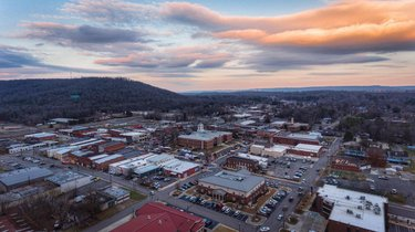 Photo by soflyvideos, caption reads: Sunset over the city square of Scottsboro before the Christmas Parade!